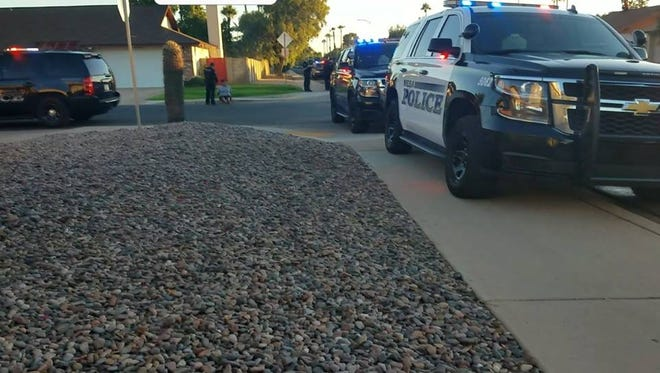 The scene after Mesa Police pulled over an Uber driver while looking for a woman involved in an assault.