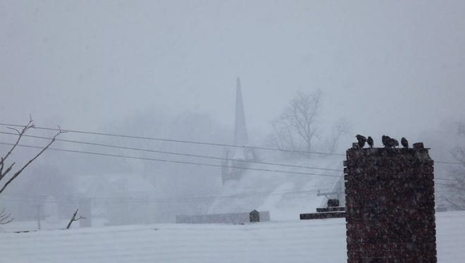 """""""Sitting Around the Fire on A Cold and Snowy Day""""(1/15/2018 - 9:21 a.m.) Church in background is Morganfield Presbyterian Church."""