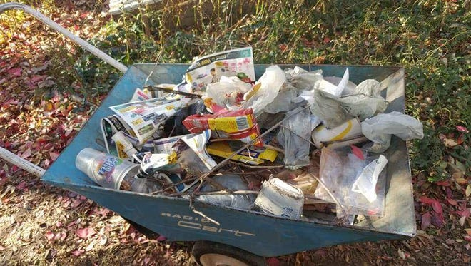 After Black Friday the Dobson family picked up two 40-gallon leaf bags full of trash.