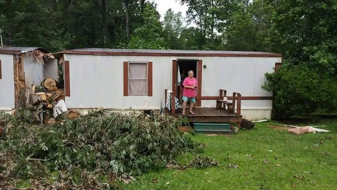 Kathy Hendricks Green at her trailer near Pickens that had just been demolished by a falling tree during a tornado.