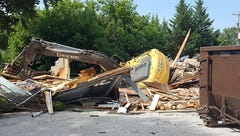 Excavator overturns Sunday while tearing down house in Hanover, fire official says