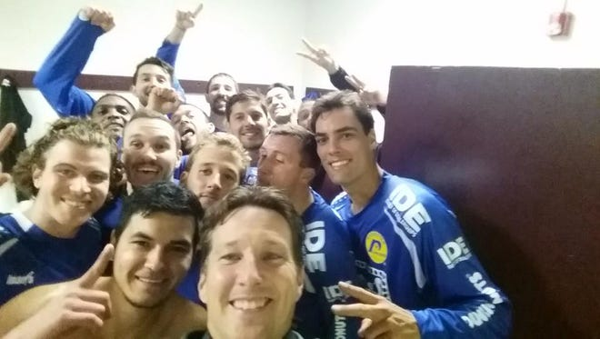 With head coach Doug Miller front and center and star forward Mauricio Salles at right, the Lancers celebrated Saturday's season-opening win with a locker room 'Selfie.""