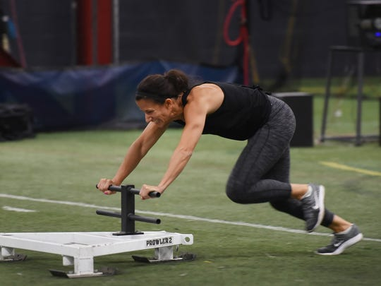 Jen Rogliano of Jericho, LI challenges a Sled Push during the Workout For Warriors event, that is  supporting military veteran charities, at Freak Strength in Oakland on 07/15/18.