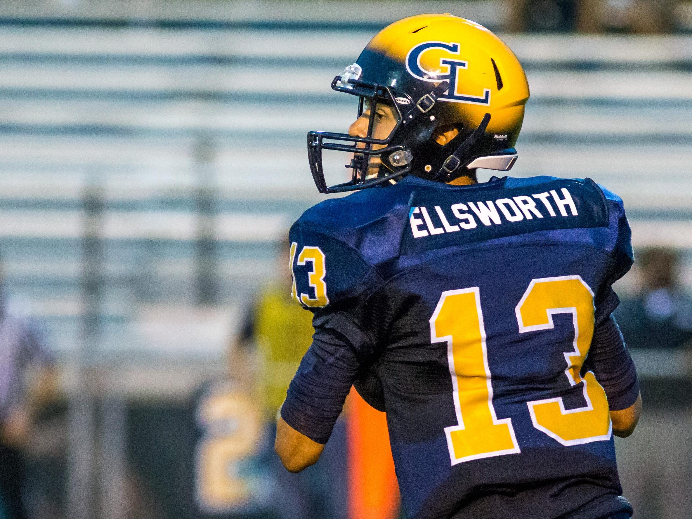 Grand Ledge quarterback Nolan Bird wears the last name of a fallen soldier during Friday's football game against Okemos.