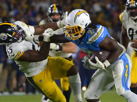 Oct 13, 2019; Carson, CA, USA; Los Angeles Chargers running back Melvin Gordon (25) carries the ball as Pittsburgh Steelers linebacker Devin Bush (55) defends during the fourth quarter at Dignity Health Sports Park. Mandatory Credit: Jake Roth-USA TODAY Sports