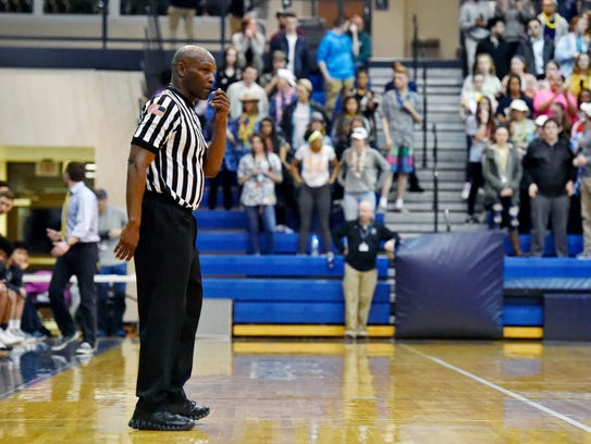 A referee keeps an eye on the action during the second
