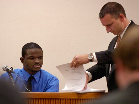 Taking the stand in his own defense, Steven Hayward, left, looks over a transcript of previous testimony along with prosecuting attorney Tom Bakkedahl on March 13, 2007, at the St. Lucie County Courthouse in Fort Pierce. Hayward was convicted of first-degree murder in the death of Fort Pierce Tribune news carrier Daniel DeStefano.