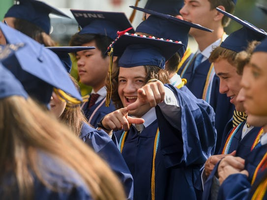 Graduate J.J. LaCorte clowns around while taking a