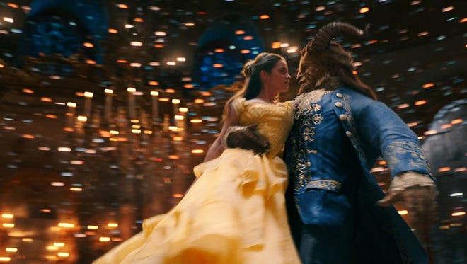"Belle (Emma Watson) enjoys a dance with the Beast (Dan Stevens) in the live action ""Beauty and the Beast."""