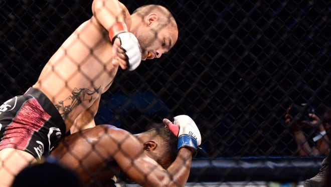"""Frank """"The Crank"""" Camacho defeated Tyrone """"Bones"""" Jones by TKO in the 155-pound main event of PXC 50 at the University of Guam Calvo Field House, Saturday, Dec. 4."""