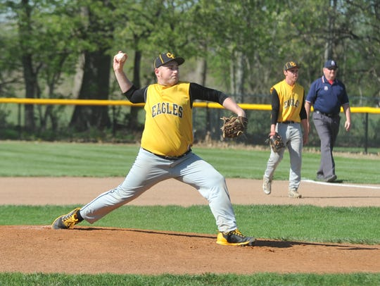 Freshman Drayton Burkhart pitches against Crestline in the sectional semifinal.