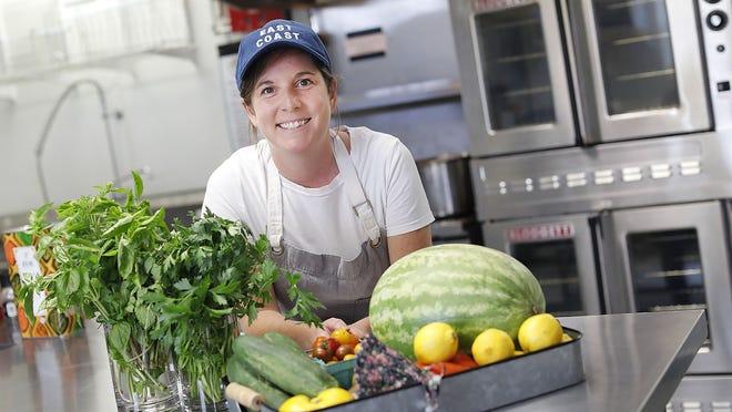 Elle Jarvis prepares dishes in a Kingston kitchen on Thursday August 6, 2020 Greg Derr/The Patriot Ledger
