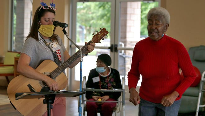 Barbara Killian dances as Hannah Coleman plays music at the Life Enrichment Center on Wednesday.