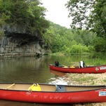 A paddler on the Jacks Fork River, part of the Ozark National Scenic Riverways.