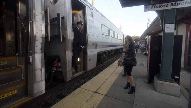 A passenger boards an NJ Transit Pascack Valley Line train in Pearl River Oct. 6, 2016. The Pascack Valley line has been running on a weekend schedule since last week's train crash in Hoboken. This train was an extra unscheduled train that was not listed on any schedule and stopped in Pearl River between scheduled trains. As a result, only four passengers boarded.