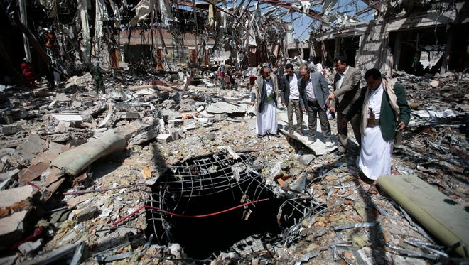 Members of a civilian group  inspect a destroyed funeral hall on Oct. 13, 2016. in Yemen's capital, Sanaa. They blamed a Saudi-led airstrike on Oct. 8 for killing more than 140 mourners.