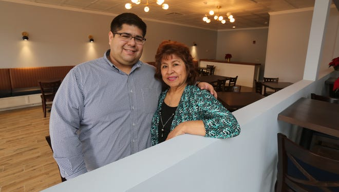 Tyrone Azanedo and his mother Maura at Maura's Kitchen on South Broadway in Nyack, Dec. 15, 2016.