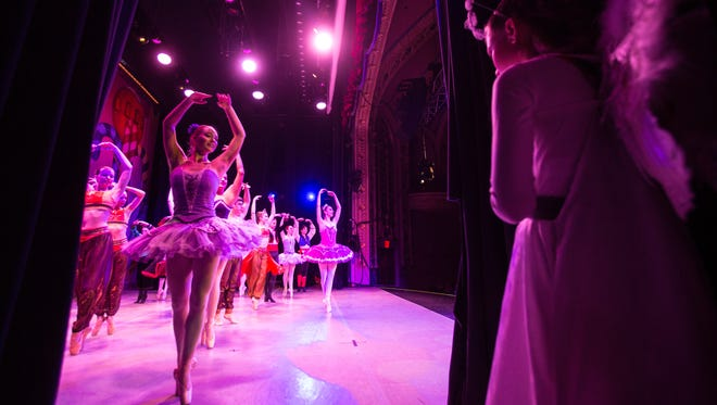 Lead Angel Elissa Parton, 11, watches from the wings as Ballet Des Moines performs its annual production of The Nutcracker for students from area schools Friday, Dec. 8, 2017.