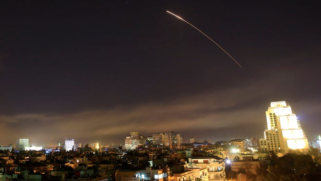 Damascus skies erupt with missile fire as the U.S. launches an attack on Syria targeting different parts of the capital Syria, early Saturday, April 14, 2018. Syria's capital has been rocked by loud explosions that lit up the sky with heavy smoke as U.S. President Donald Trump announced airstrikes in retaliation for the country's alleged use of chemical weapons.