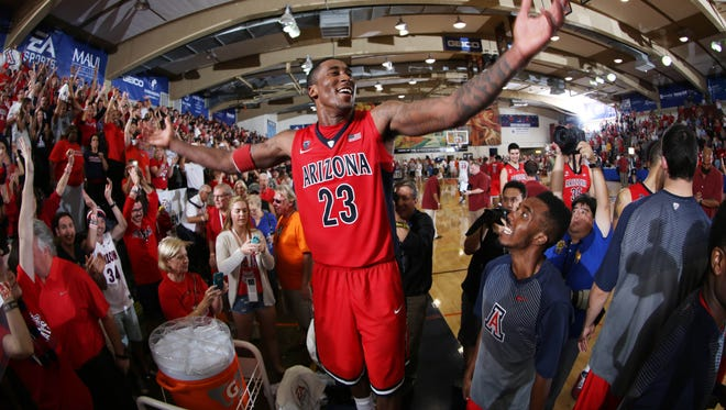 Rondae Hollis-Jefferson celebrates with the fans in the stands.