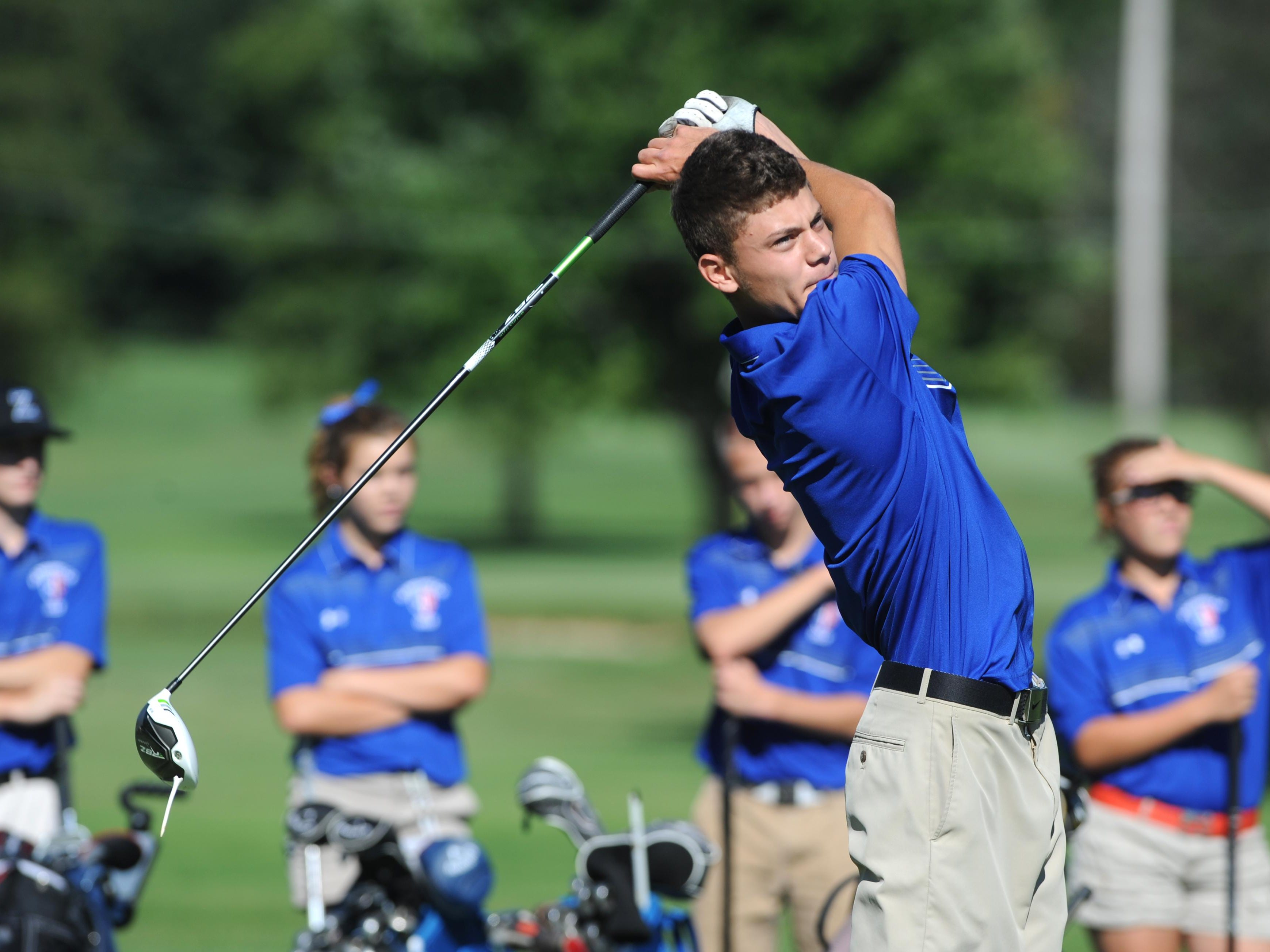 Zanesville's J.J. Burns tees off during the Michele Redman Cup at Zanesville Country Club on Monday.