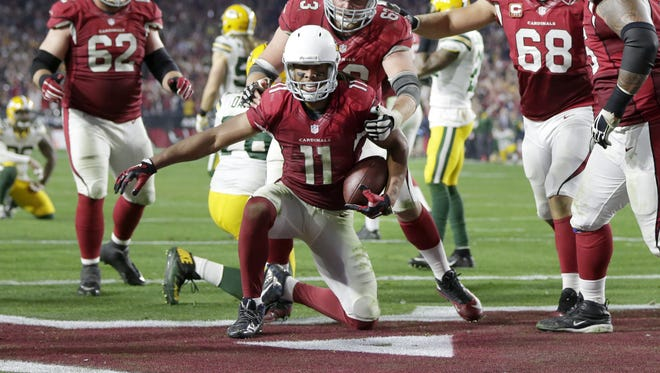 Arizona Cardinals receiver Larry Fitzgerald scores a touchdown in overtime to defeat the Packers 26-20.