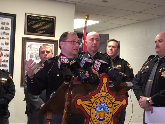 Richland County Sheriff Steve Sheldon released details Monday about a nine-hour standoff Sunday involving armed robbery and burglary suspect Eric Patrick. Ashland County Lt. Scott Smart looks on over Sheldon's shoulder and Huron County Sheriff Dane Howard stands to the left.
