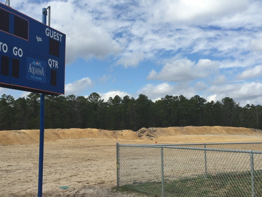 This cleared, sandy area is where new athletic fields