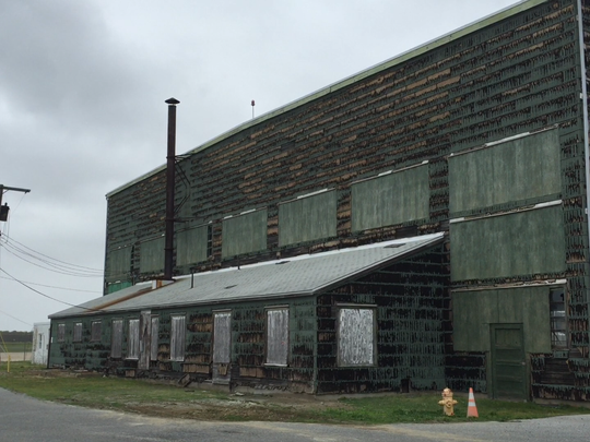 """The 'Green hangar,"""" named for its paint scheme, is a relic of the Millville Municipal Airport's start in the early 1940s as the nation's first air defense base. The Millville Army Air Field Museum and others dream of its complete restoration."""