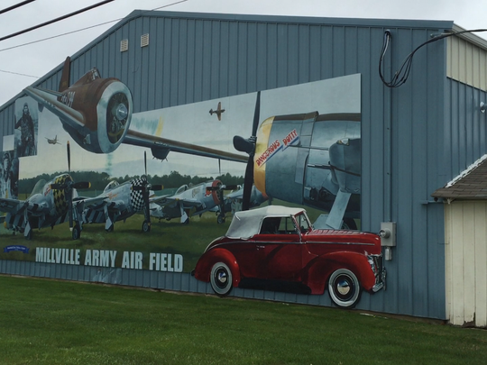 A building mural captures a bit of the historical essence of the Millville Municipal Airport.