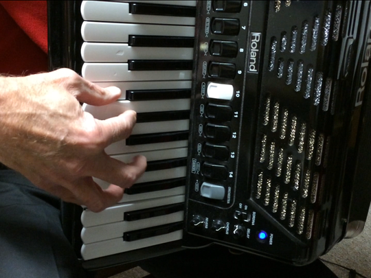 Mike DeSciscio uses a digital accordion to enhance his abilities to play different kinds of music on the instrument.