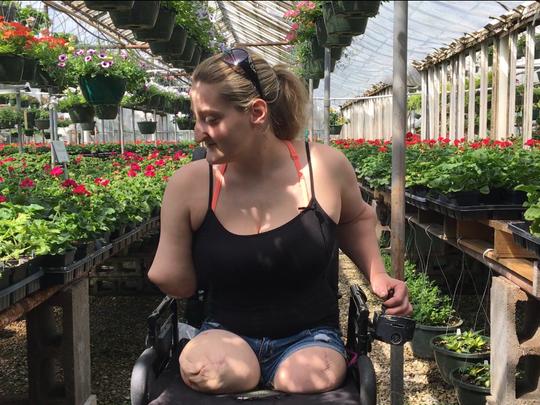 Amanda Smith admires the flowers at the Elberfeld Gardens
