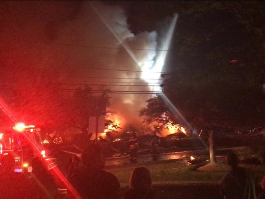 A witness took some photos of the early Sunday morning house explosion in Piscataway.