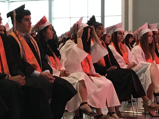 The class of 2017 from Fort Lee High School listens