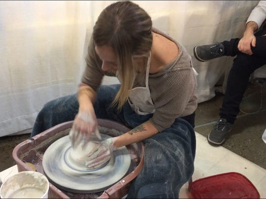 A potter spins her wheel at Spring Craft Morristown at the Morristown National Guard Armory. March 17, 2018.