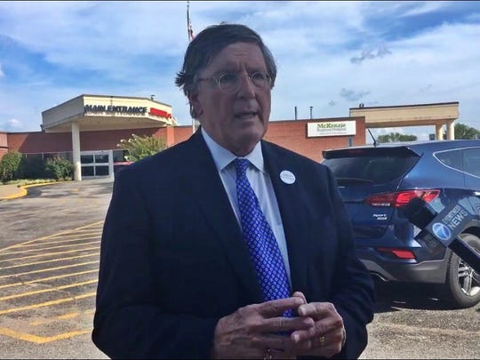 Craig Fitzhugh discusses hospital closings in rural Tennessee in front of the McKenzie Regional Center, who announced its closing coming up on Sept. 15.