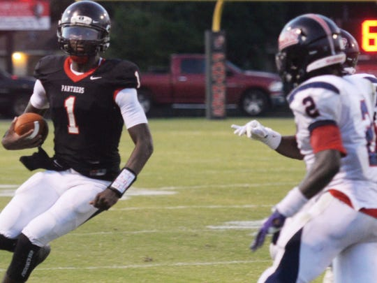 Parkway quarterback Justin Rogers looks to run in a
