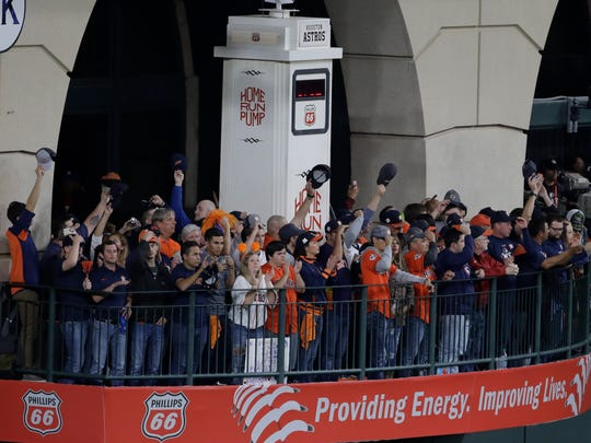 Fans cheer during the seventh inning of Game 4 of baseball's World Series between the Houston Astros and the Los Angeles Dodgers Saturday, Oct. 28, 2017, in Houston. (AP Photo/Eric Gay)