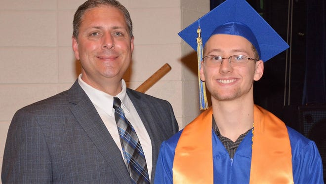 Oconto Kiwanis Club member Bill Gallagher Jr. stands with Dustin Olsen, who received a $2,000 scholarship from the club. This is the 20th year the club has awarded a $2,000 scholarship to a graduating senior.