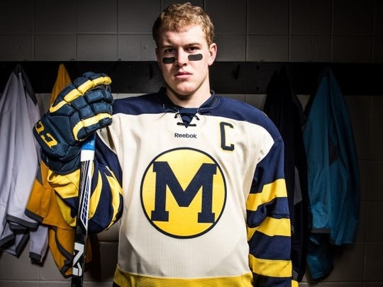 Michigan's Andrew Copp models the alternate jersey the Wolverines will wear against MSU in the Hockey City Classic on Feb. 7 at Soldier Field in Chicago.