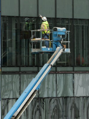 Work continues on the Lake Trust Credit Union building with crews installing windows at the back of the building which is located on the southeast corner of Spencer Road and Old US-23 in Brighton Twp.