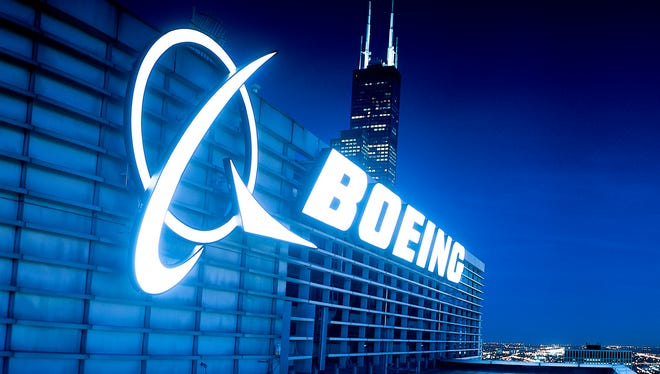 This photo provided by Boeing shows the company's logo sign atop its corporate headquarters in Chicago.