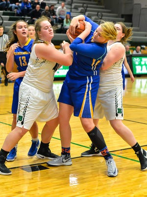 Hamilton Badin's Emma Broermann fights for the ball against Rebekah Justice of Mariemont.