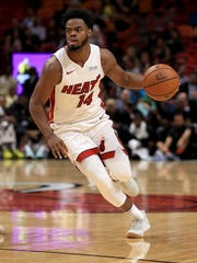 Derrick Walton Jr. #14 of the Miami Heat drives during a preseason game against the Washington Wizards at American Airlines Arena on October 11, 2017 in Miami, Florida.