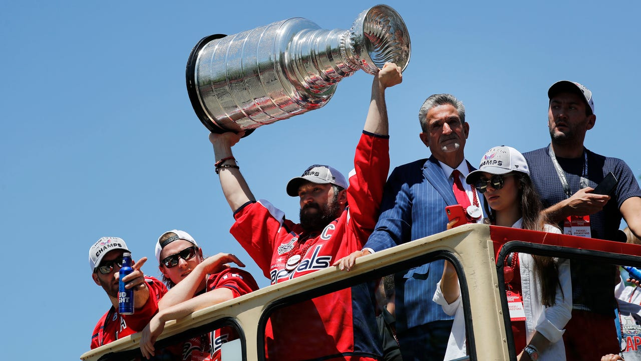 Tens of thousands of fans lined the route along Constitution Avenue and thousands more gathered on the National Mall to celebrate the Stanley Cup champion Washington Capitals. (June 12)