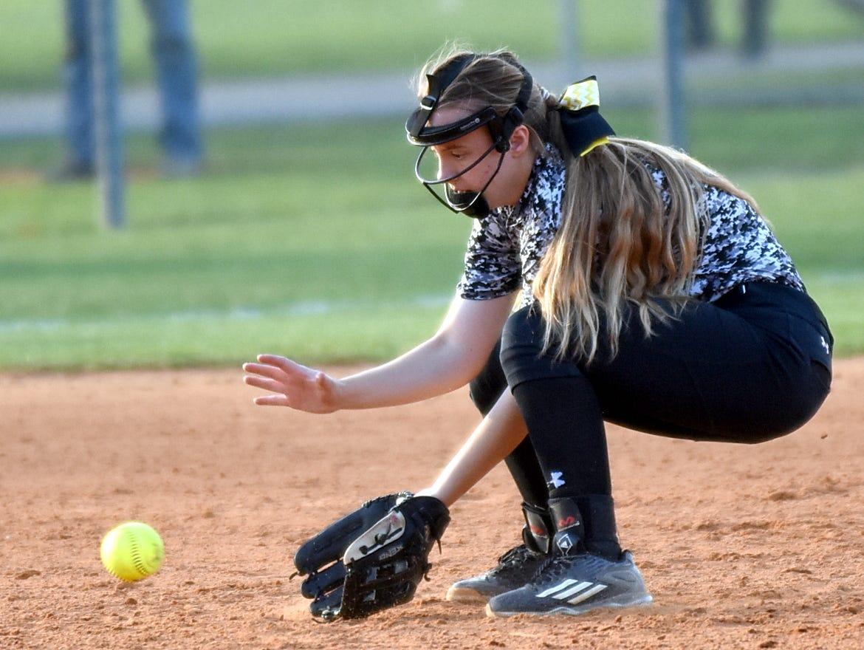Hendersonville High junior shortstop Lexi Revis fields a third-inning ground ball.