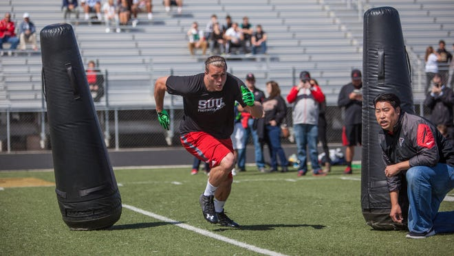 James Cowser runs a drill for NFL scouts at Southern Utah's Pro Day, Wednesday, Mar. 30, 2016.