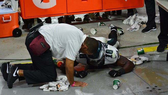 Jeremy Maclin was sent flying into a Gatorade table.