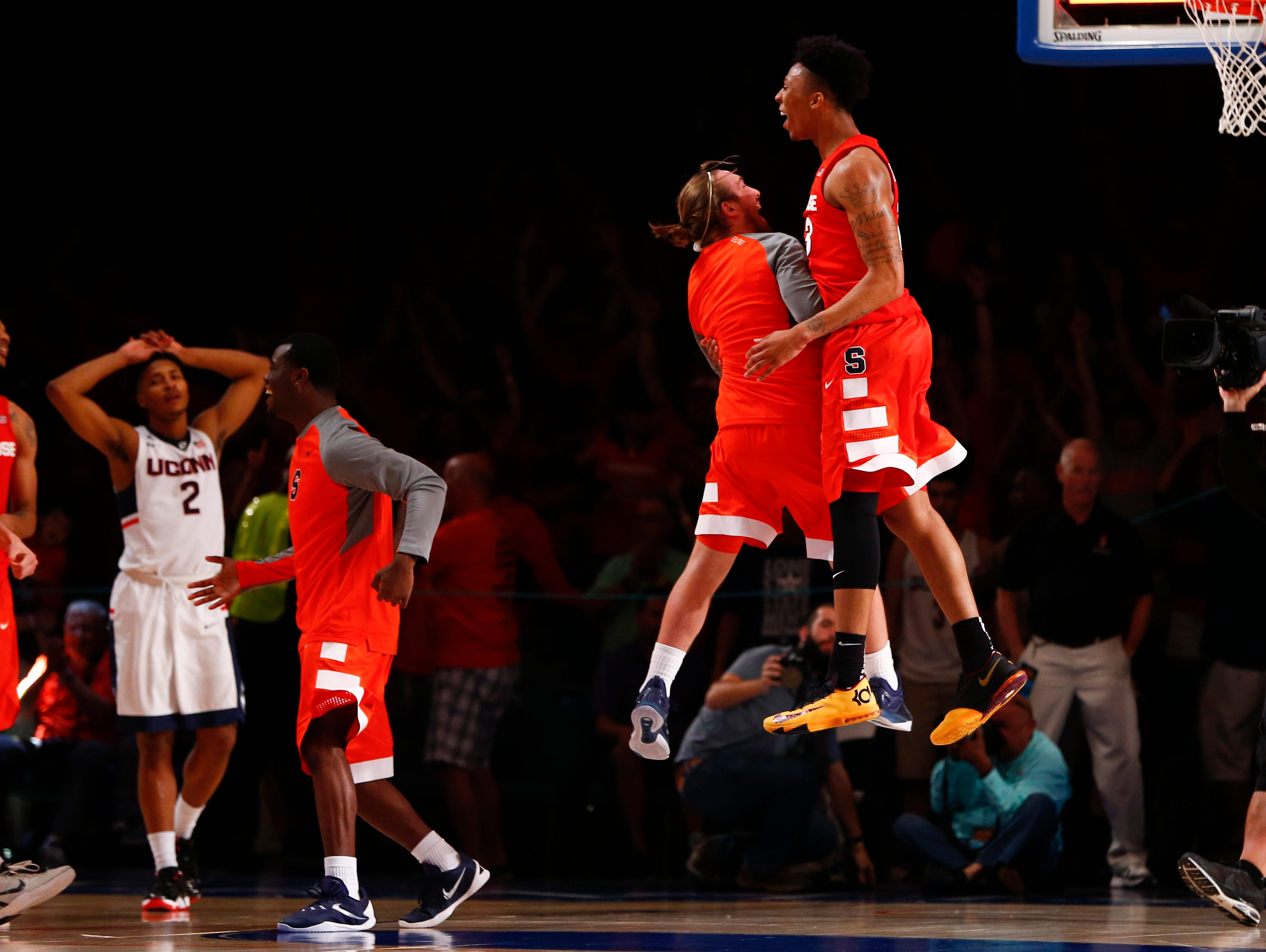 Syracuse Orange guard Malachi Richardson (far right) celebrates the victory with teammates.