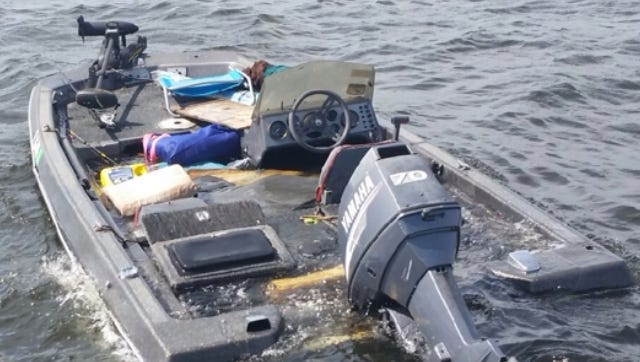Charlotte County units responded to Charlotte Harbor Thursday, finding four people in the water wearing their personal flotation vests.  The boat itself was mostly under water.